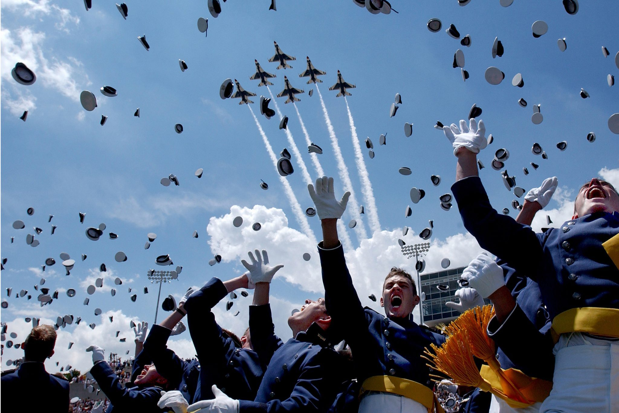Newly commissioned officers celebrate their graduation from U.S. Air Force Academy